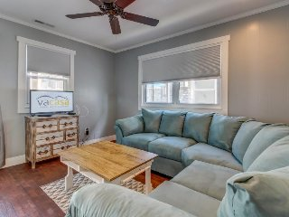 Bright, modern condo just moments from soft sandy beach!