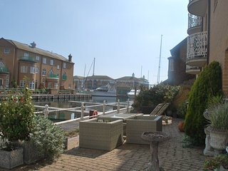 Two bedroom ground floor apartment with large terrace on the water's edge.
