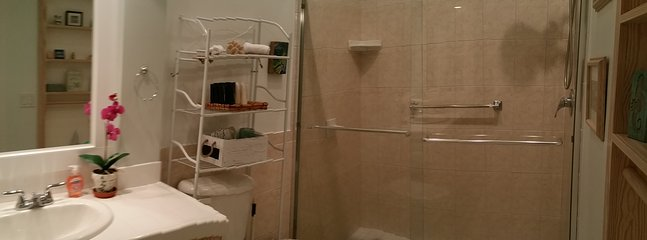 Master full bath in the middle of both bedrooms upstairs.