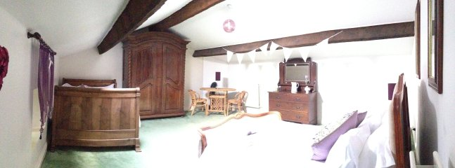 Bedroom three in pano view. Two double beds.