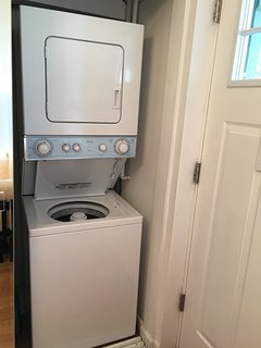 Stacked washer and dryer in your unit.