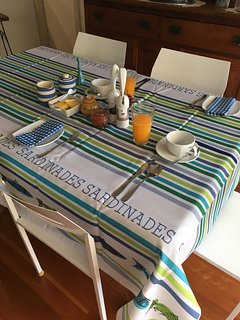 Indoor breakfast setting. Full cooked breakfast, fruit and toast included in price