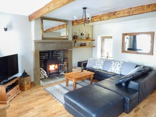 MULBERRY COTTAGE, stone-built terraced cottage, character features, woodburner, Haworth