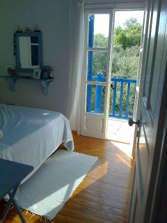 Another shot of the double bedroom with olive trees in the background.