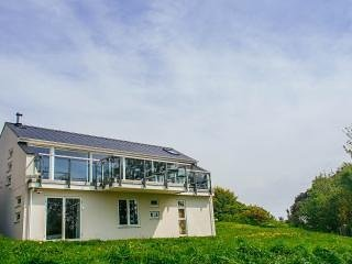 Architect owned and built Aberdovey home overlooking Cardigan Bay, aluguéis de temporada em Aberdyfi (Aberdovey)