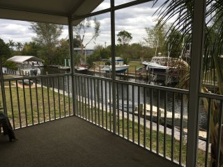 Tropic Bird, a boaters retreat, waterfront canal home with dock