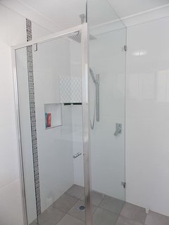 New modern shower cleaned regularly.