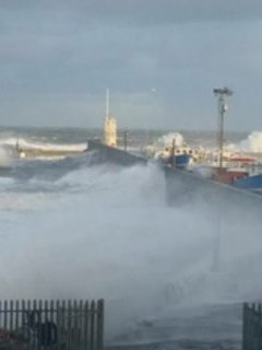 Seahouses Harbour on a spring evening with high tides