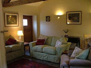 The Calf Pens sitting room - with log burner, TV, wifi