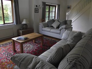 Newly furnished open plan lounge with double French doors leading to private rear garden
