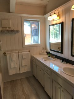 Double sinks with stand-up  tub and shower