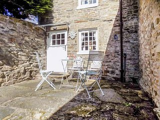 PUZZLE COTTAGE, stone-built, semi-detached, over 3 floors, multi-fuel stove, in