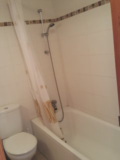 Family bathroom with bath, shower, toilet and sink