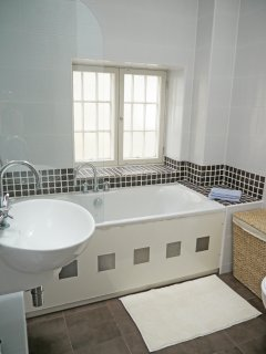 main bathroom has a bath and a shower, all recently renovated