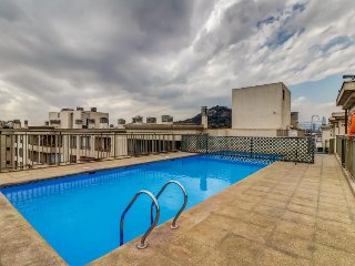 Cozy condo in city center features shared pool - small dogs welcome!
