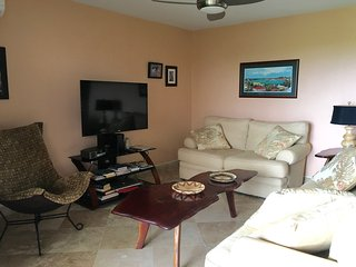 living room with comfortable furniture and large screen TV