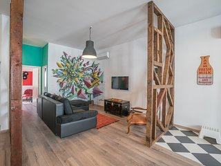 open plan living/kitchen/dinning with 'modern' tile grafite by local artist