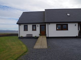 The Annexe with stunning views over Lochindaal and to the Paps of Jura - private garden to the side