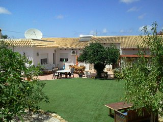 Villa with private pool and tennis court, 1500 m2, mature gardens and parking.