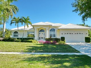 Pleasant home on the water w/ heated pool & southern exposure