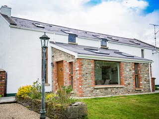 Traditional stone barn converted to luxurious self catering accommodation. Large sun room window.