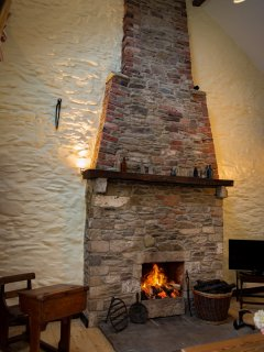 Splendid stone built fireplace with large open fire