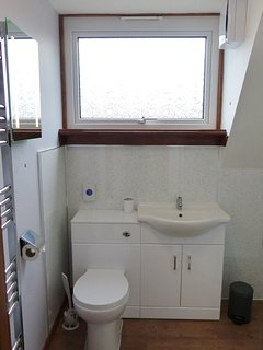 Heated towel rail, mirror with shaver socket, toilet and storage for your things