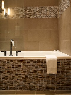 The 2nd Master Bath has a hydrotherapy tub with heated back rest
