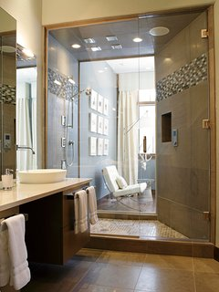 The Master Shower has an 8-head shower system in addition to the soaking tub