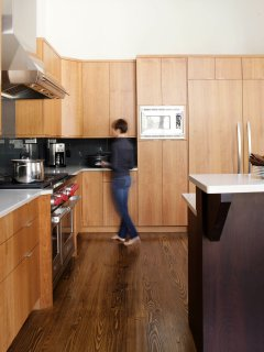 The custom Kitchen features 48'' Wolf range and 60' Thermador fridge/freezer