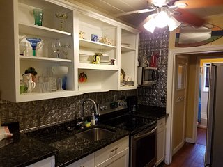 Restored 1925 kitchen with tin walls