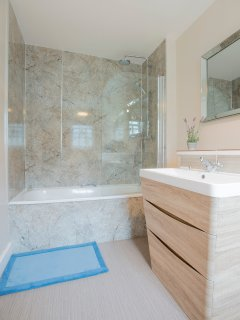 The en suite bathroom has both a steel lined bath and a double shower.