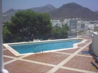 Estudio para dos personas con piscina comunitaria