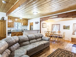 Open living and dining area with oak floors and pine ceilings