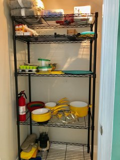 Fully stocked pantry with pots and pans