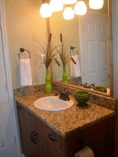 2nd bathroom complete with granite and a full size bathtub and shower.