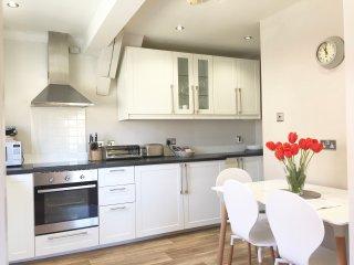 Scandi - style kitchen newly fitted with dishwasher, fridge, freezer, washer/dryer, microwave.