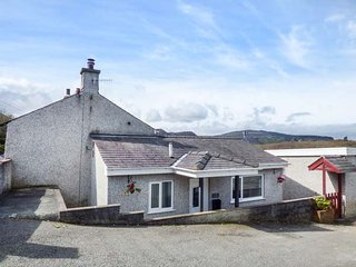 ARFRYN, semi-detached, enclosed garden, woodburning stove, pretty views, in