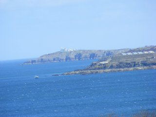 Caravan, on headland private land, Anglesey, with glorious sea views.