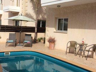 Enjoy relaxing around the pool.