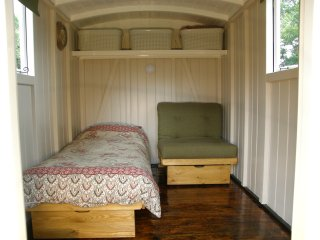 One bed fully open with the other closed up as a setee.  Can be set as one double or 2 single beds.