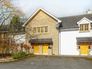 NO 3 THE COURTYARD, first floor apartment, romantic retreat, woodburning stove, Belturbet