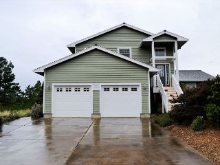 SEA ESCAPE~ MCA# 898~Spacious home with golf course view and hot tub!