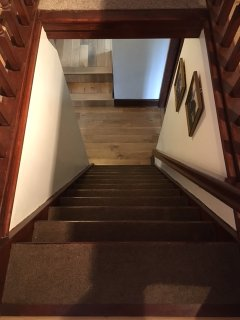 Looking down the steep staircase from the upstairs bed room