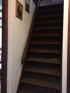 The steep staircase leading to the upstairs bed room