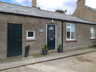 CUTHBERT'S COTTAGE, pet friendly, country holiday cottage, with a garden in Belf