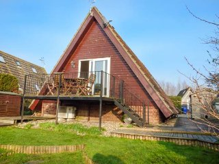 RIVERSIDE LODGE, pet friendly, country holiday cottage, with a garden in Isleham, Ref 1703