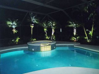 Enjoy the hot bubbling spa at night under the romantic lighting around the pool.