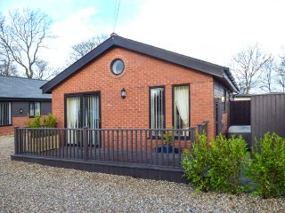 DAMSON COTTAGE, all ground floor, open plan property with a private enclosed