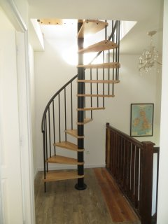 Spiral staircase leading to loft